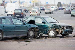 Car crash happening along the highway.