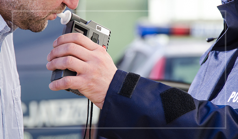 A man blowing into a breathalyzer in Houston, Texas.