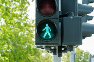 Pedestrian walk signal in the middle of the road.