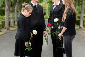 Sad daughter attending funeral of her late dad that had accident working offshore.