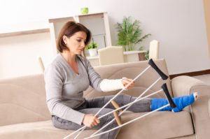 Injured woman holding her crutches.