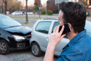 Driver calling the police to report car accident.